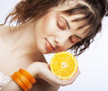 Woman's face with juicy orange Stock Photography