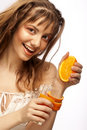 Woman's face with juicy orange Stock Photos