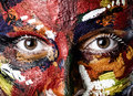 A woman's face in oil paints Stock Photos