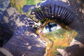 Woman`s face with planet Earth texture and finnish flag inside the eye Royalty Free Stock Photo