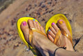 Woman s feet on the beach Stock Photo