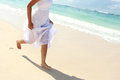 Woman s foot while running on the beach portrait of Royalty Free Stock Images