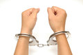 A woman's hand in handcuffs Stock Images
