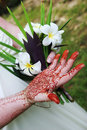 Woman's hand with henna design and fragapani bouquet Royalty Free Stock Photo