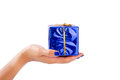 Woman's hand holding a big blue parcel Royalty Free Stock Photo