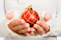 Woman's hand holding a Christmas ball Royalty Free Stock Images