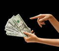 Woman's hand holding dollars money. Royalty Free Stock Photo