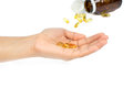 Woman`s hand holding Fish oil capsules with omega 3 and vitamin D healthy diet concept