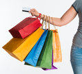 Woman s hand holding shopping bags and credit card female Stock Photography