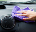 Woman s hand with microfiber cloth polishing wheel of a car Royalty Free Stock Images