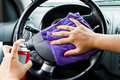 Woman s hand with microfiber cloth polishing wheel of a car Stock Photography