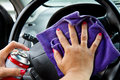 Woman s hand with microfiber cloth polishing wheel of a car Royalty Free Stock Photography