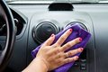 Woman s hand with microfiber cloth polishing wheel of a car Stock Photos