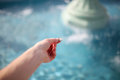 Woman`s Hand Throwing Coin in Wishing Fountain Royalty Free Stock Photo