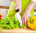 Woman's hands cutting vegetables Stock Photo