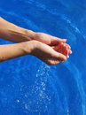Woman's hands with fresh water Royalty Free Stock Photo