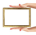 Woman's hands with golden frame isolated on white Royalty Free Stock Photo