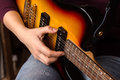 Woman s hands playing electric guitar close up focus right hand Royalty Free Stock Photo