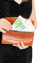 Woman s hands with purse and money on white Stock Image