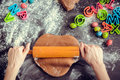 Woman's hands sheeting dough with rolling pin Royalty Free Stock Photo