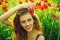 Woman`s happiness. pretty woman or happy girl in field of poppy seed Royalty Free Stock Photo