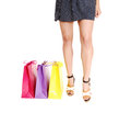 Woman s legs with bag s a young in high heels three colorful shopping isolated on white background Stock Photos