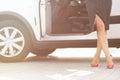 Woman's legs near car