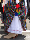 Woman s traditional regional costume of la orotava tenerife in the canary islands close up showing striped skirt lace petticoat Stock Photography