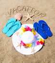 Woman s white hat on the sandy beach with starfishes seashell decoration and sign vacation Stock Image
