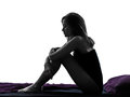 Woman sad despair sitting in bed silhouette Royalty Free Stock Photo