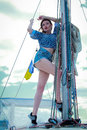 woman on the sailboat. Beautiful young woman in striped clothes Royalty Free Stock Photo