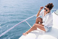 Woman sailing in a yacht on her summer holidays Stock Photos