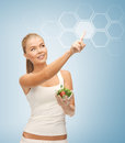 Woman with salad and virtual screen Stock Photo