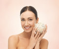 Woman with salt ball for bathing Royalty Free Stock Photo