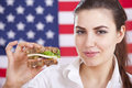 Woman with sandwich over american flag Royalty Free Stock Photos