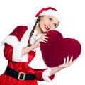 Woman santa claus christmas heart pillow Royalty Free Stock Images