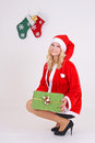 Woman in santa costume with gift Royalty Free Stock Photo
