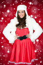 Woman in santa costume and white furry hat Royalty Free Stock Image