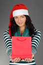 Woman in santa hat with  bag Royalty Free Stock Image