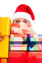 Woman in Santa hat and Christmas gifts Royalty Free Stock Photo