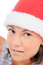 Woman in santa hat close up beauty Royalty Free Stock Image