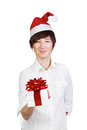 Woman in Santa hat giving gift box Stock Photos