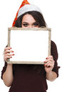 Woman in Santa hat holding big white card Royalty Free Stock Photo