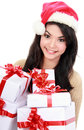 Woman in Santa hat holding Christmas gifts Stock Photography