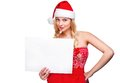 Woman in santa hat holding empty board Stock Photos