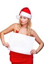 Woman in santa hat holding empty board Royalty Free Stock Photography