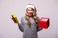 Woman in Santa hat open Christmas gift