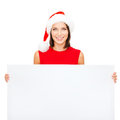 Woman in santa helper hat with blank white board christmas x mas people advertisement sale concept happy Stock Photography