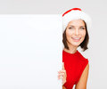 Woman in santa helper hat with blank white board christmas x mas people advertisement sale concept happy Royalty Free Stock Image