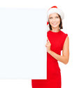 Woman in santa helper hat with blank white board christmas x mas people advertisement sale concept happy Royalty Free Stock Photography